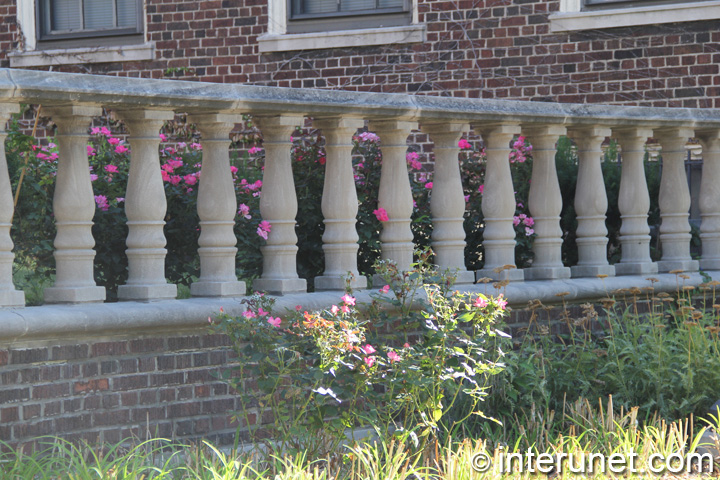 brick fence with concrete balusters