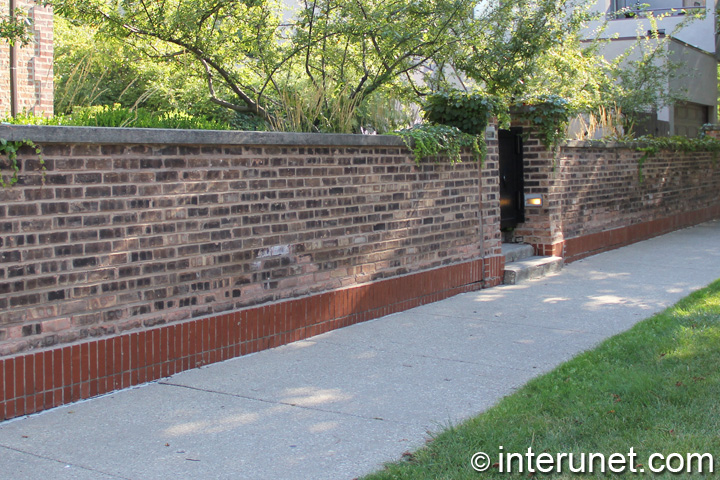brick fence with concrete sills on top
