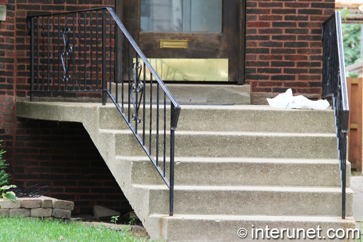 concrete-stairs-and-porch-with-metal-railing