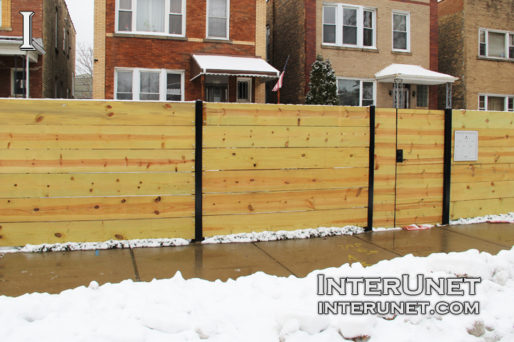 Horizontal Boards Wood Fence On Steel Posts