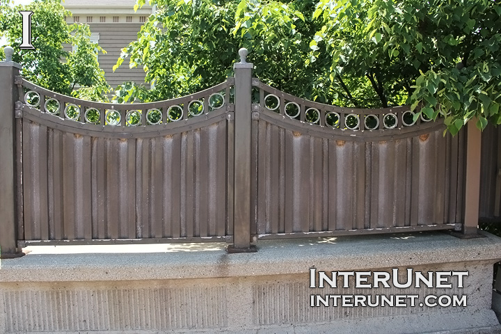 custom made metal fence on concrete foundation