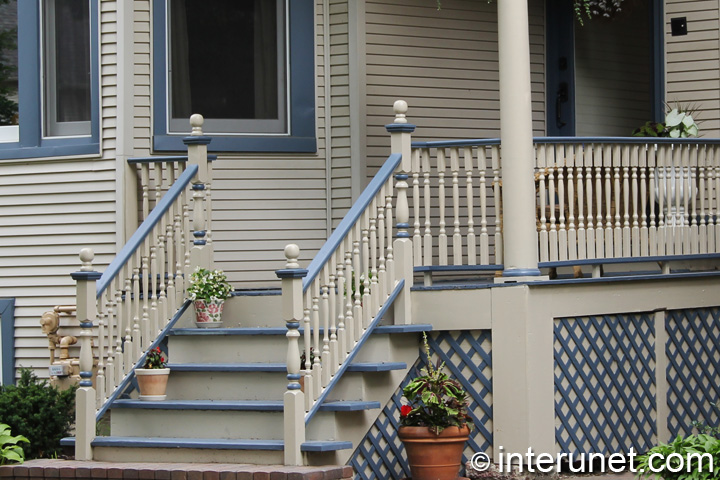 nice-front-porch-decorated-with-flowers-in-pots