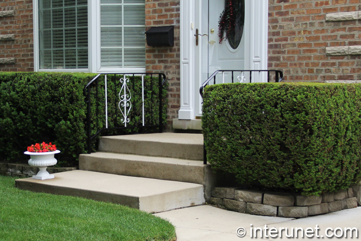 simple-concrete-porch-with-metal-balustrades
