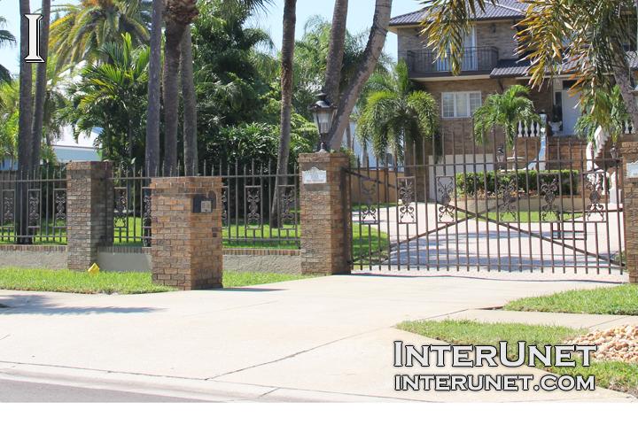 steel-fence-on-brick-pillars