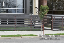 black-wood-horizontal-fence-on-metal-posts