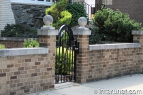 brick fence with metal gate