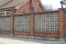 brick-fence-with-concrete-blocks-and-lights-on-pillars