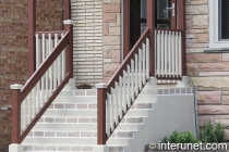 combination-of-concrete-porch-with-wood-railing