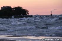 big waves on Lake Michigan during sunset