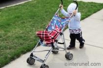 child-pushing-stroller