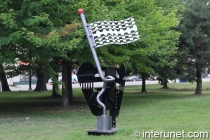 """Funky Flag with Pole Protector / Never Surrender"" sculpture in Chicago by Charles Yost"