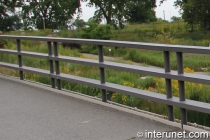 horizontal steel fence on the bridge