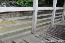 horizontal-boards-wood-fence-on-bridge