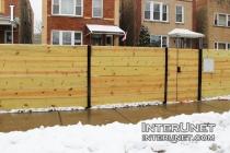 horizontal-boards-wood-fence-on-steel-posts