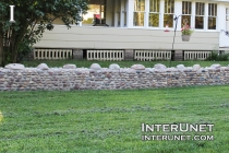 low-stone-fence-with-bigger-rocks-on-top