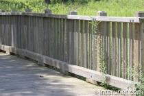 lumber-fence-on-wood-bridge