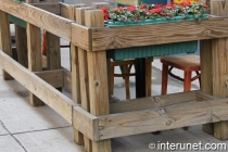 pressure treated lumber fence decorated with flowers