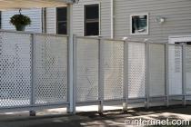 simple-lattice-wood-fence-painted-white