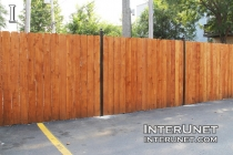 stained-cedar-fence-on-metal-posts