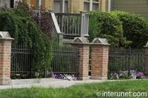 stylish-steel-fence-with-brick-pillars