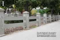 two-rail-fence-with-concrete-pillars