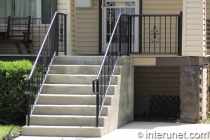wood-porch-concrete-steps-steel-railing-combination