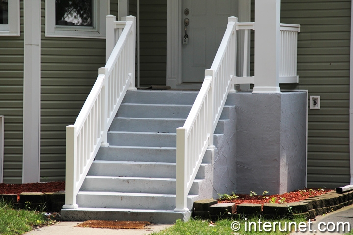 concrete-porch-and-stairs-with-white-balustrades