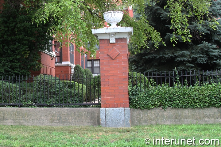 steel-fence-with-brick-pillars