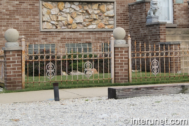 stylish-metal-fence-with-brick-pillars