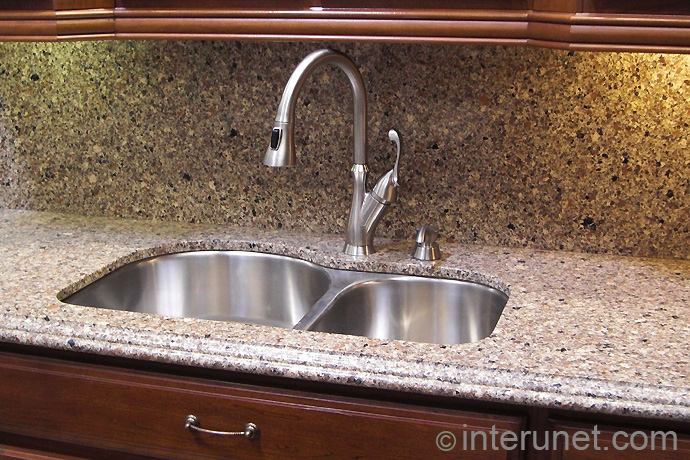 synthetic-stone-countertop-with-undermount-sink-and-kitchen-faucet