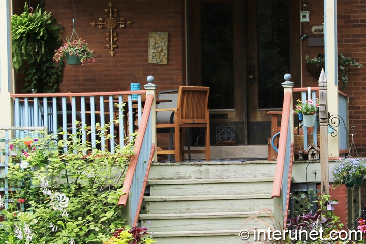 wood-porch-decorated-with-flowers