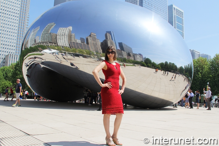 women-in-front-of-Cloud-Gate-in-red-crochet-dress