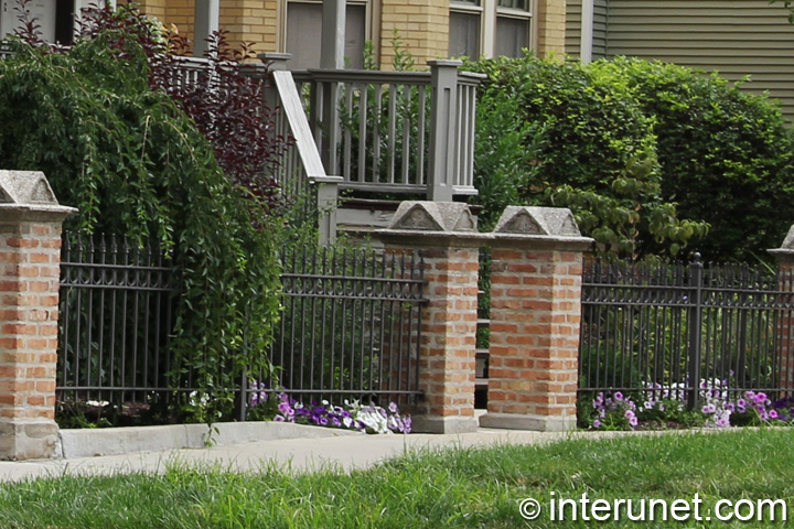 stylish-steel-fence-with-brick-pillars