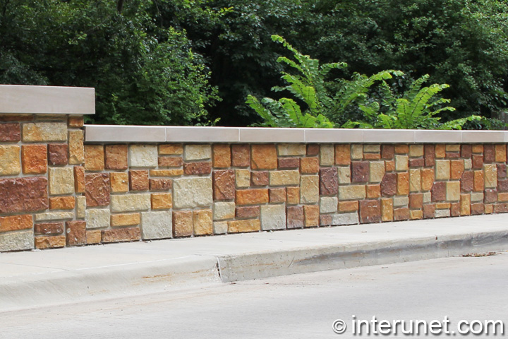Stylish stone fence with concrete sills interunet