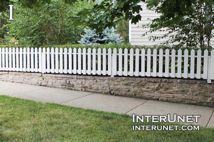 white-picket-fence-on-stone-foundation