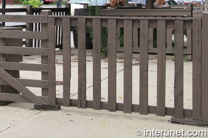 wood-fence-with-horizontal-and-vertical-boards