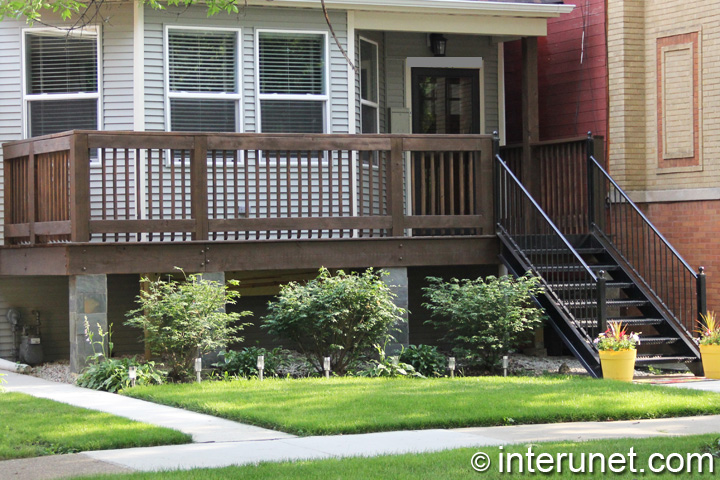 wood-front-porch-with-steel-stairs