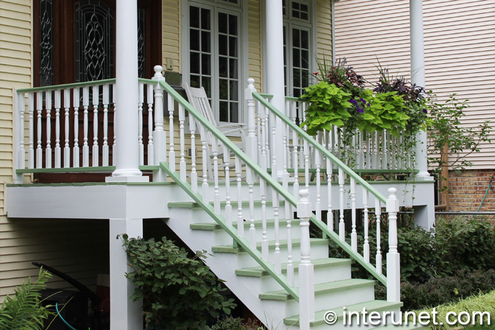 wood-porch-painted-white-and-decorated-with-plants