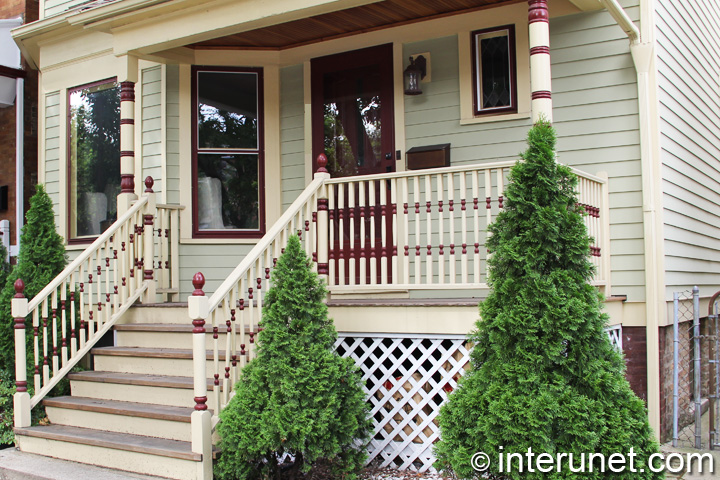 wood-porch-with-stylish-railing
