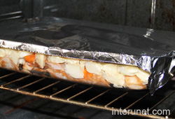 baking-tray-covered-with-aluminum-foil-placed-into-the-oven