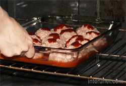 placing-tray-with-meatballs-into-preheated-oven