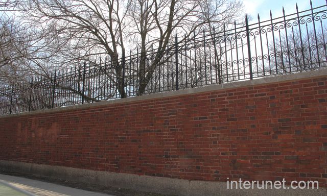 brick wall with metal fence on top - Brick Wall Fence Designs
