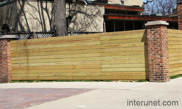 Fence With Brick Pillars And Horizontal Wood Boards