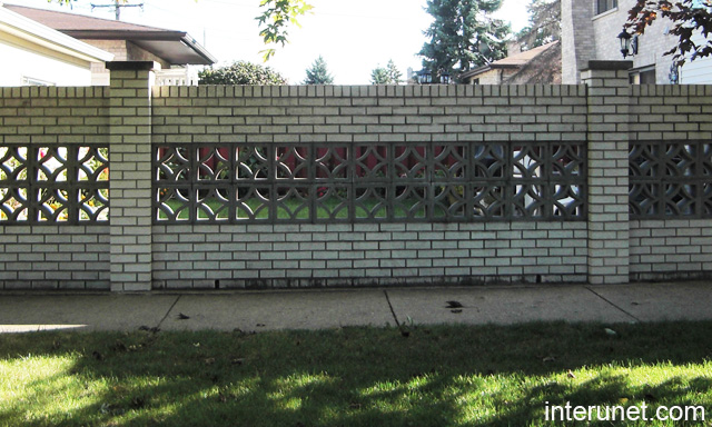 Brick Fence With Decorative Concrete Blocks