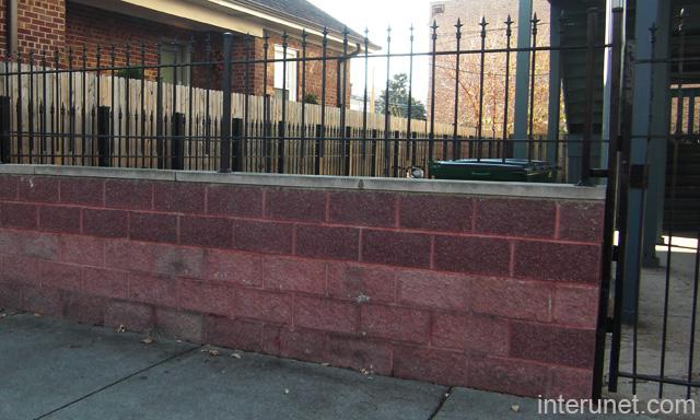 100 concrete block fence block wall fencing phoenixrcp block metal fence over red concrete blocks picture interunet workwithnaturefo