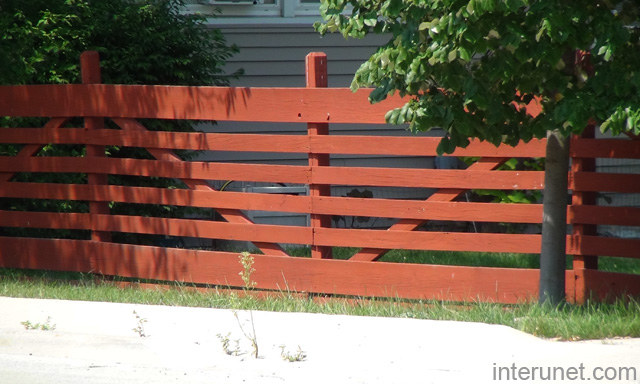 Wood Fence With Horizontal Boards Painted Red